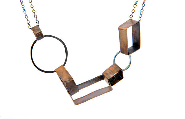Brass and Silver Oxidized Shapes Necklace Olivia de Soria