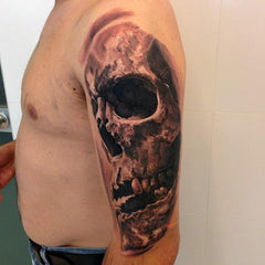 skull full arm tattoo