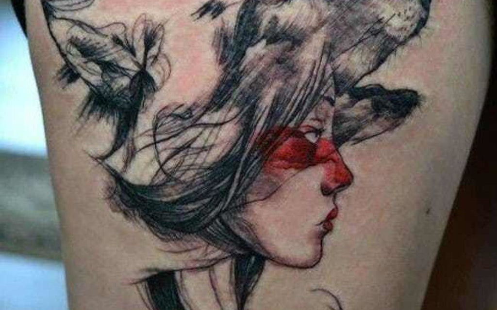 red woman face tattoo