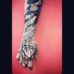 Black arm tattoo sleeve design photo