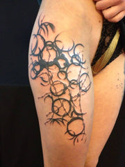 simple shapes woman tattoo