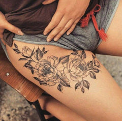simple flower leg tattoo
