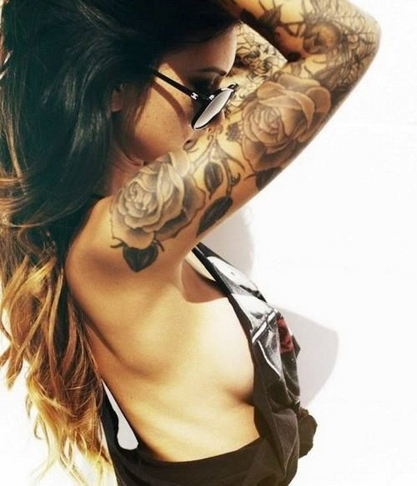 woman full arm tattoo