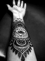 black and white arm tattoo collage