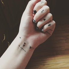 simple wrist tattoo design