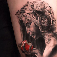 woman apple tattoo