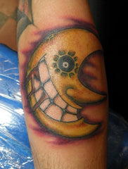 cartoon moon design tattoo