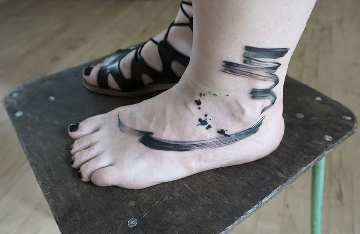 brush foot tattoo
