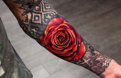 red rose tattoo arm