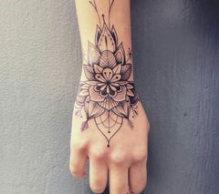 hand flower tattoo