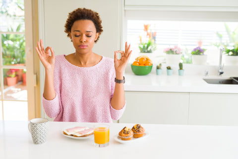 Mindful eating, without distractions, can improve digestion and reduce stress.