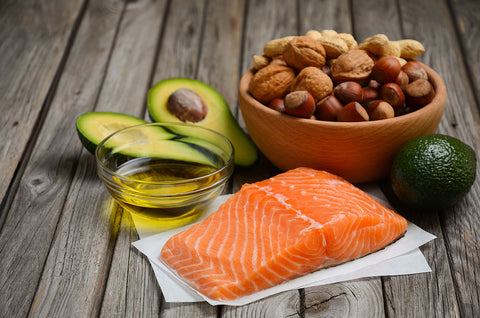 Healthy fats include salmon, avocado, olive oil, and whole nuts and seeds.