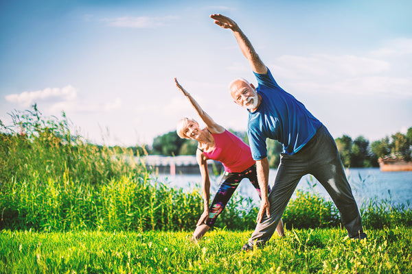 healthy active seniors stretching; a healthy and unique microbiome extends lifespan in older adults