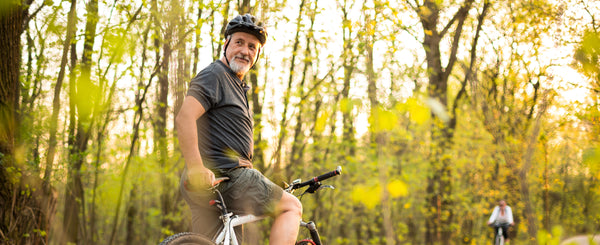 man on bike; these results pave the way for using new immunotherapies to treat age-related diseases related to senescent cell buildup — and possibly for treating aging itself.
