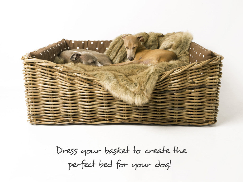 Rattan Basket dressed with Dotty Chcocolate Mattress & Bumper Set and Faux-Fur Blanket in Foxy
