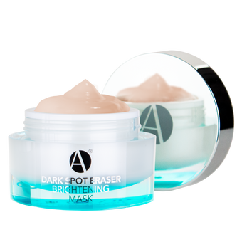 ANJALI MD Dark Spot Eraser Brightening Mask (Open) a round acrylic jar with a light blue glow at the bottom and the light yellow pinkish cream peaking out of the jar. The chrome cap appears to the back with the A logo reflecting the product