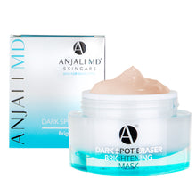 ANJALI MD Dark Spot Eraser Mask appears in the round glass jar with a blue glow beneath. The orange-ish pink-ish jelly mask is peaking over the top of an open jar. The box appears in the background with the ANJALI MD logo vertical on a box that is a blue to white gradient.