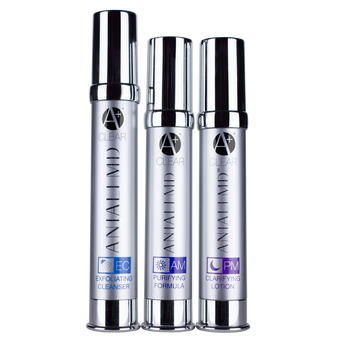ANJALI MD Teen Acne System. All 3 Products in tall chrome bottles. From left to right: Exfoliating Cleanser, AM Purifying Formula and PM Clarifying Lotion. All with A+ CLEAR logo in chrome.