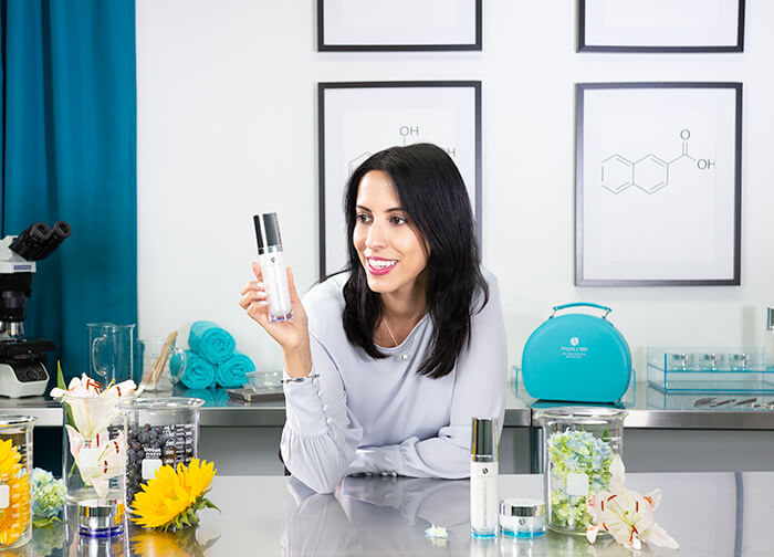 Dr. Anjali in her Lab, looking at Rapid Brightening Serum