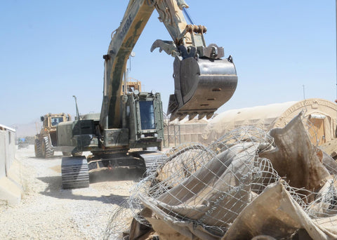 Demolition using geotextiles and wire to mitigate clean-up