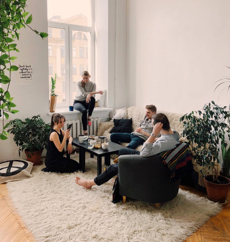 People in an apartment with their plants