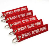 Remove Before Firing Keychain - Red/White