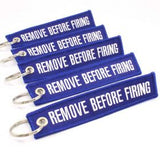Remove Before Firing Keychain - Blue/White