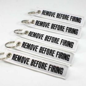 Remove Before Firing Keychain - White/Black