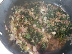 Nettles, onion, garlic, and herbs