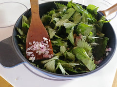 Nettles added to onion and garlic