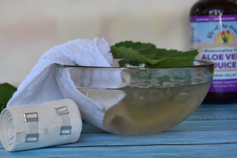 Slippery Elm Compress with towel, bandage and aloe juice