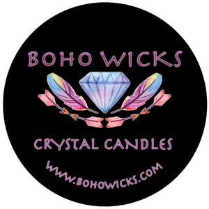 Crystal nestled in feathers and arrow. Boho wicks crystal candles
