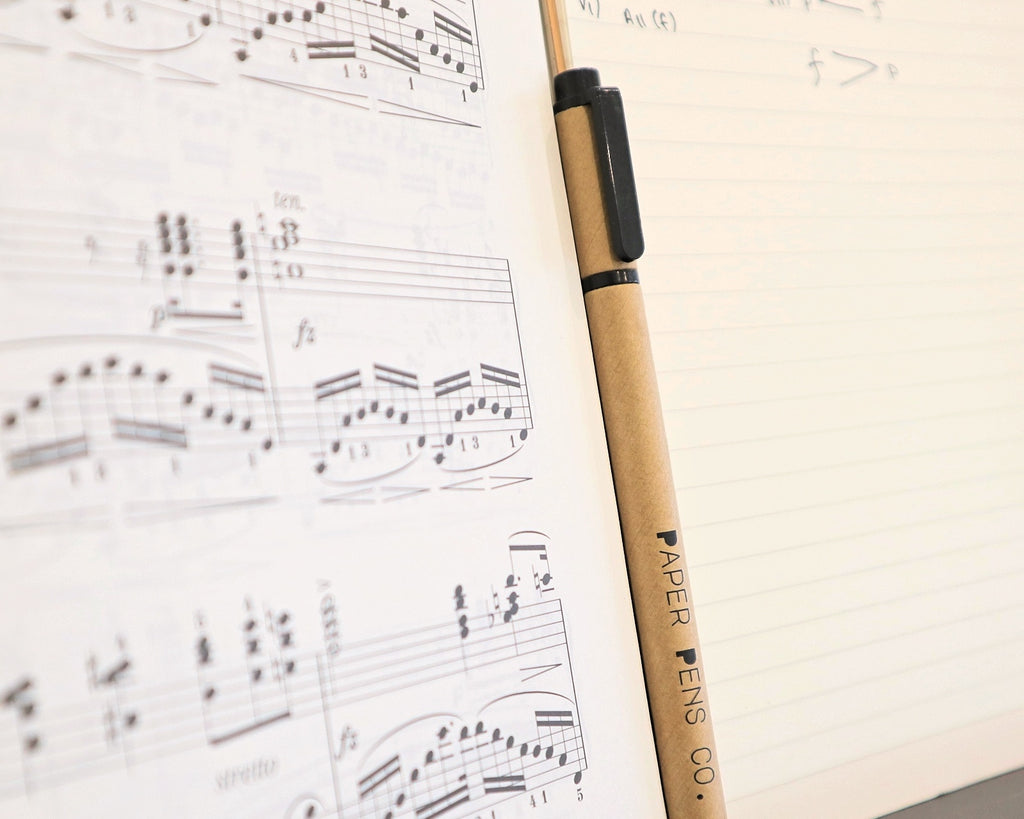 Paper Pen next to music notes