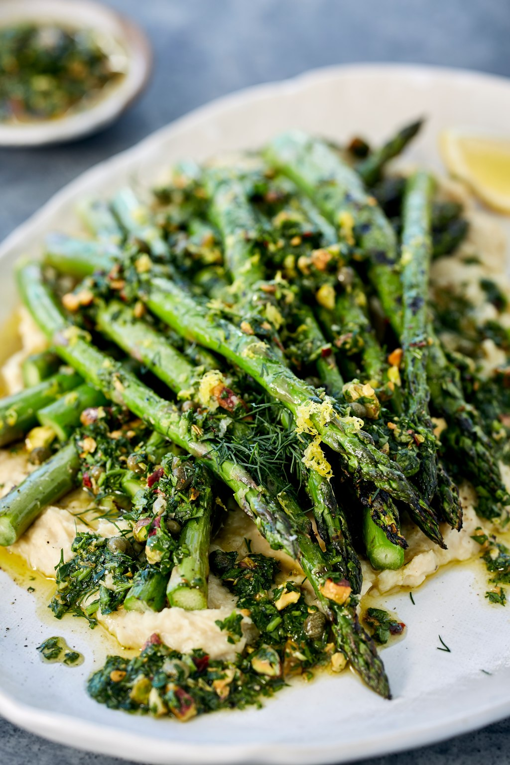 Chargrilled Asparagus with Crushed Butterbeans, Pistachio & Caper Salsa | Harris Farm Markets
