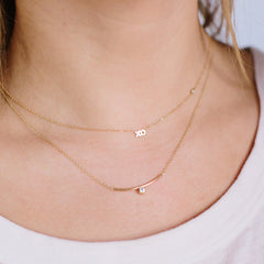 14k itty bitty XO necklace with floating diamond