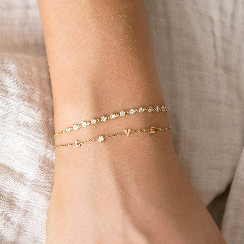 14k itty bitty & diamond spread out LOVE bracelet