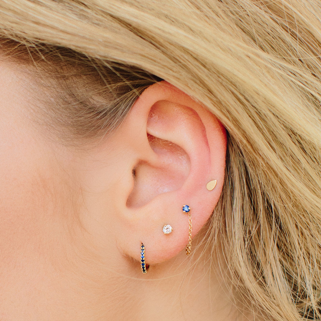 14k itty bitty tear stud
