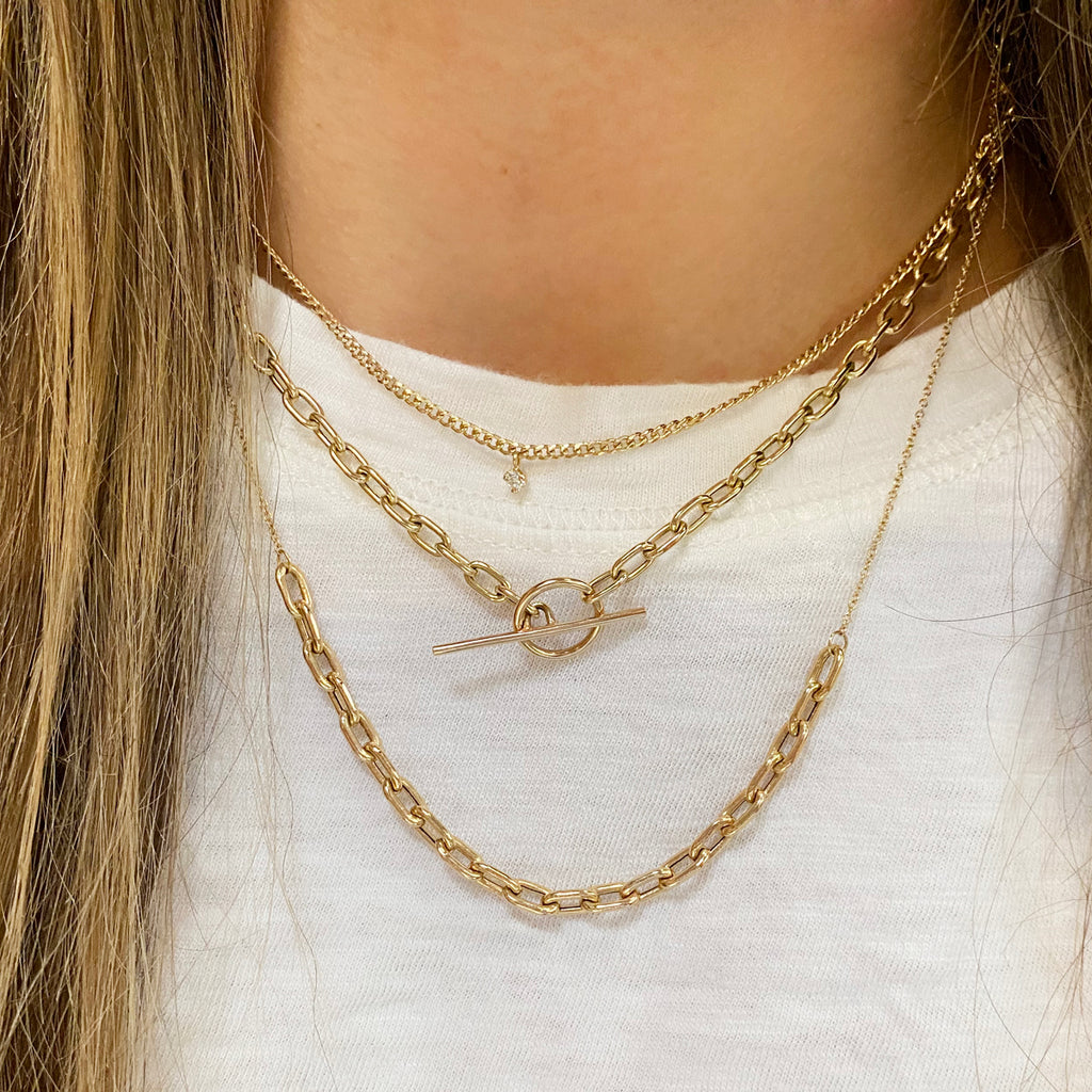 14k gold extra small curb chain necklace with a prong diamond