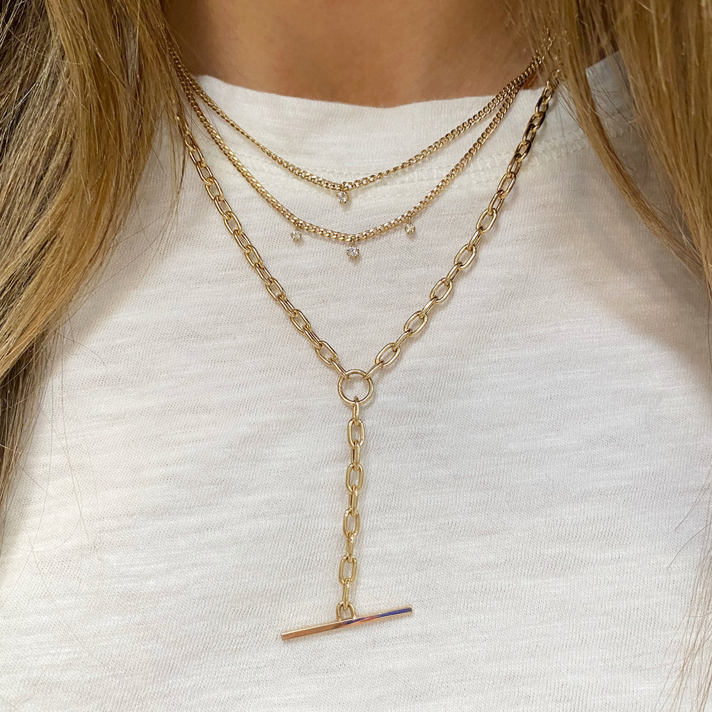 14k gold extra small curb chain necklace with 3 prong diamonds