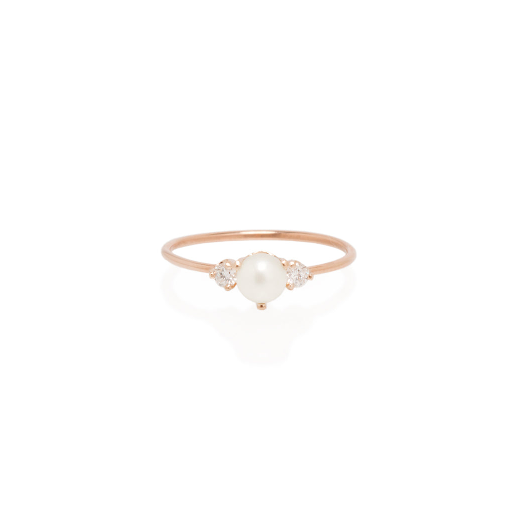 14k prong set diamond and pearl ring