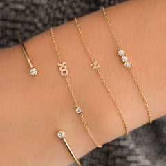 14k itty bitty XO bracelet with floating diamond