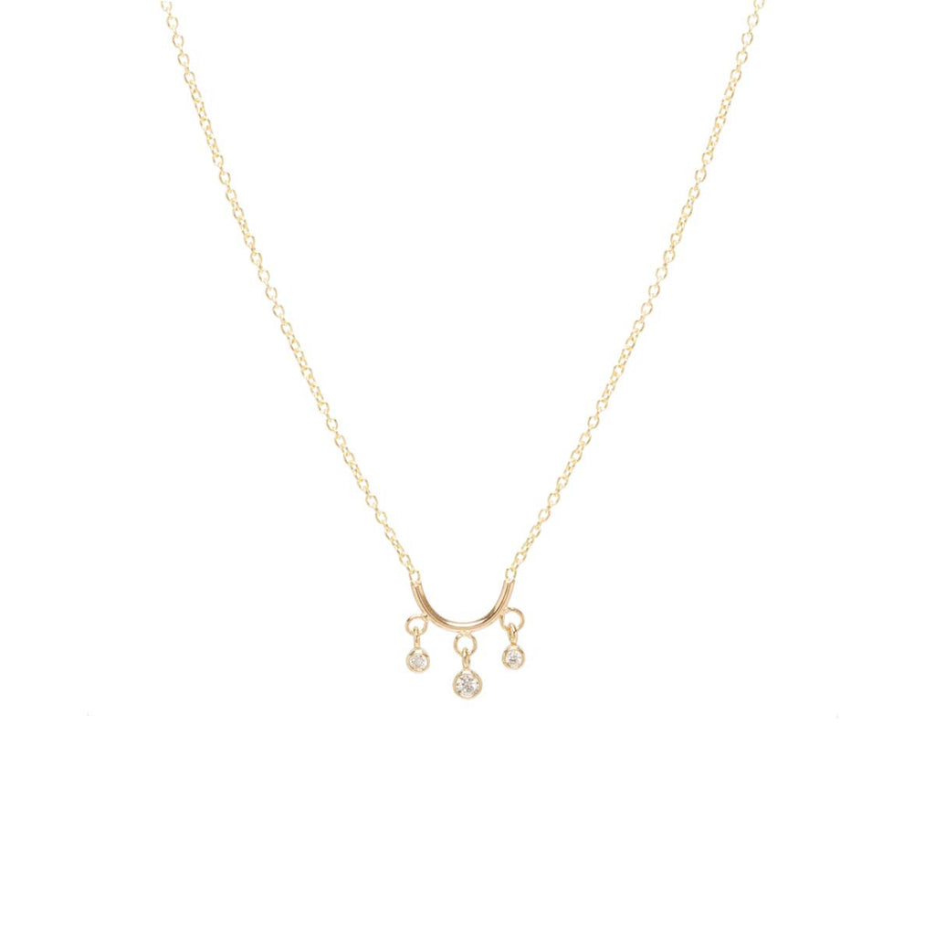 14k tiny curved bar necklace with dangling diamonds