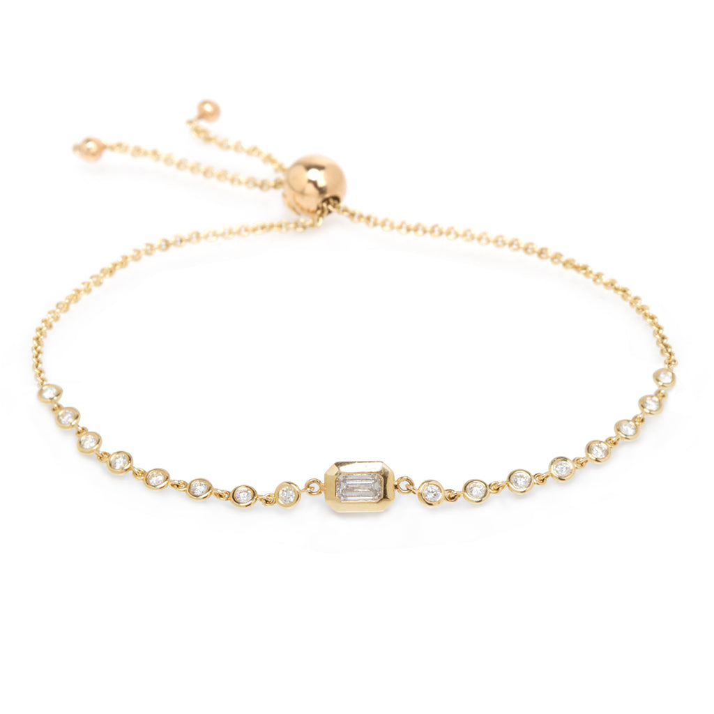 14k bolo tennis bracelet with emerald cut diamond