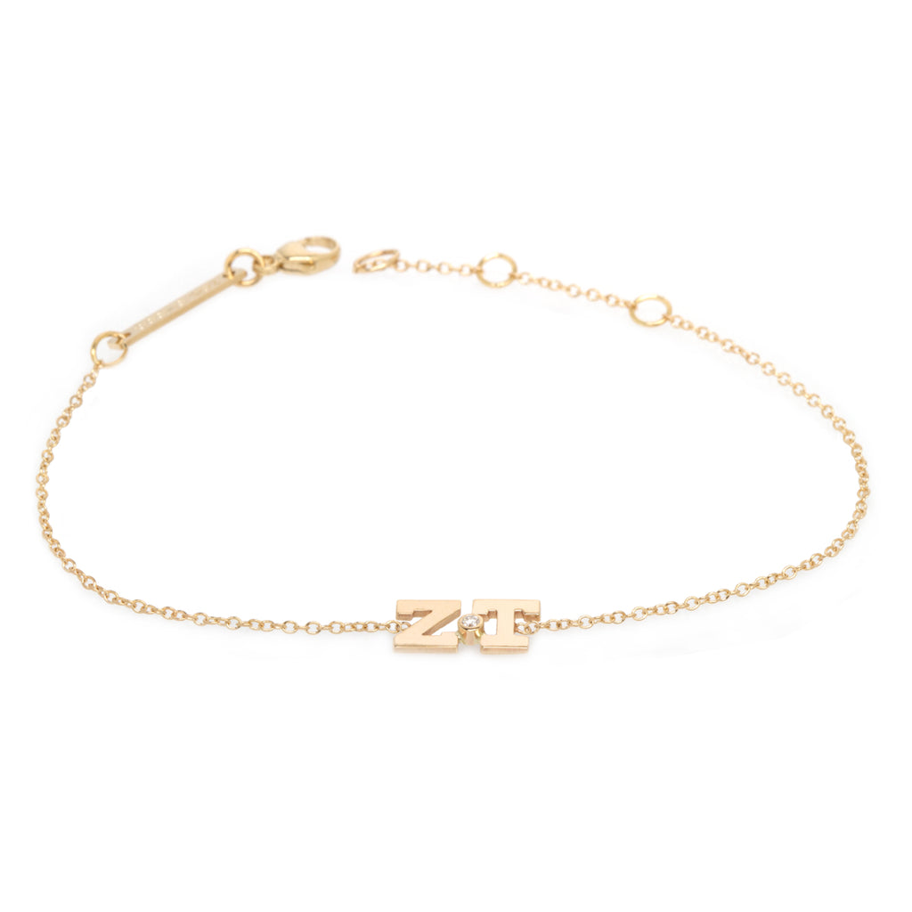 14k two letter bracelet with bezel set diamond