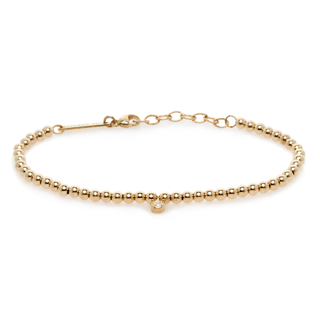 14k small gold bead and bezel diamond bracelet
