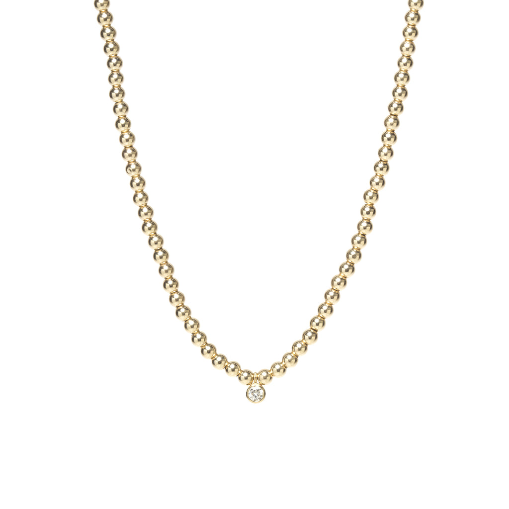 14k gold bead and dangling bezel diamond necklace