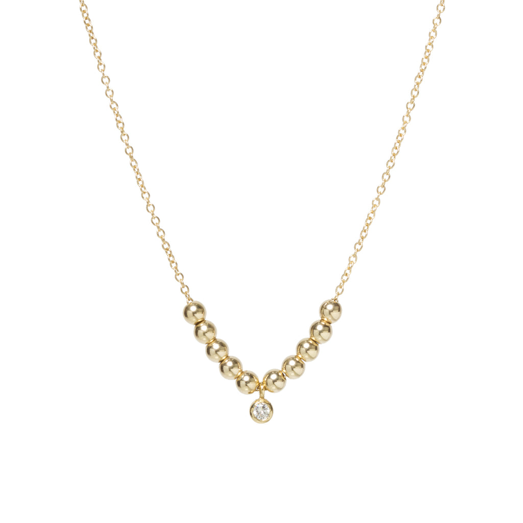 14k small gold bead and bezel diamond necklace