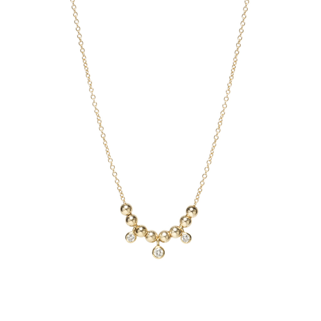 14k small gold bead and graduated bezel diamond necklace
