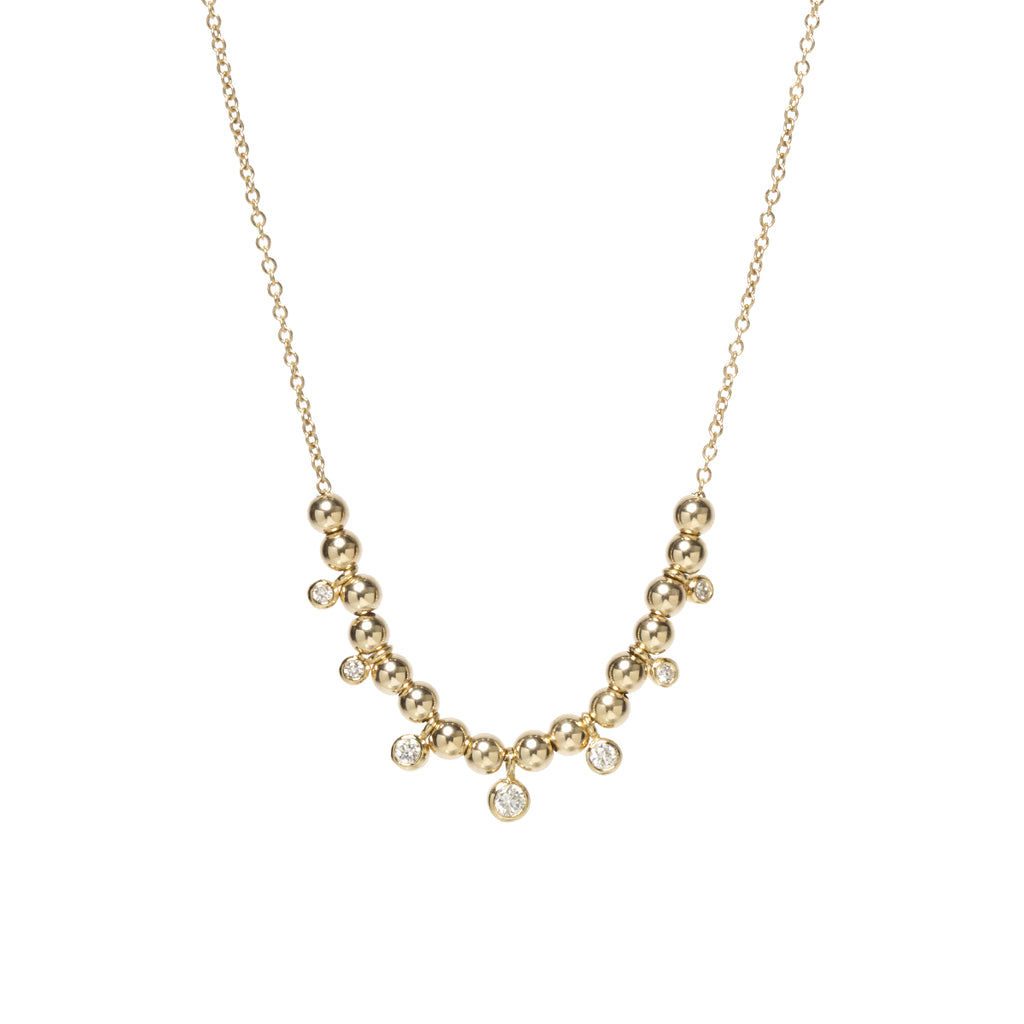 14k gold bead and graduated dangling bezel diamond necklace