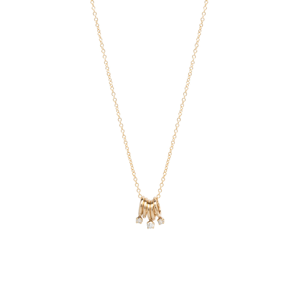 14k 5 tiny rings necklace with 3 prong diamonds
